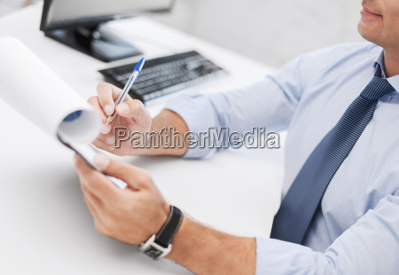 businessman working and signing papers
