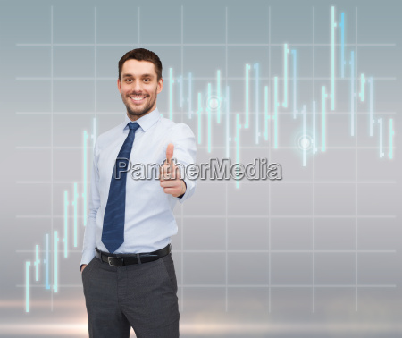 handsome businessman showing thumbs up