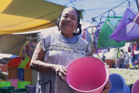 proud mexican woman holding a pink
