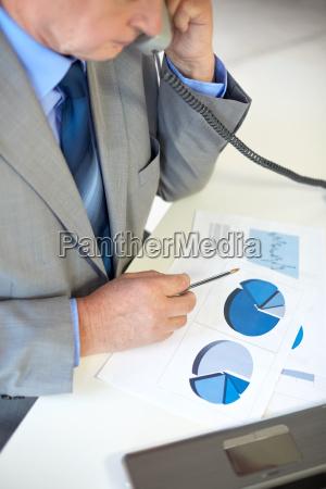 close up of senior businessman calling