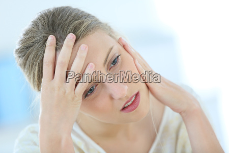 beautiful blond woman having a headache