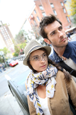 couple in town standing in shopping