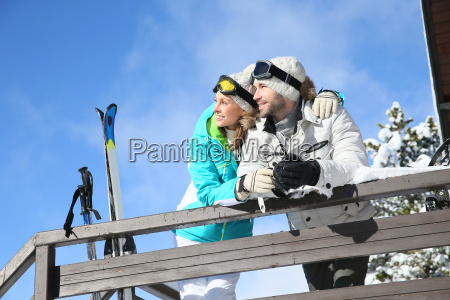 couple of skiers admiring panorama from