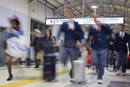 business people traveling by tokyo metro
