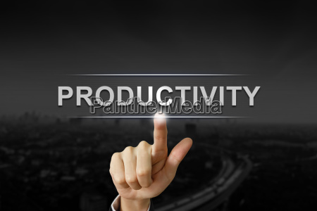 business hand pushing productivity button on