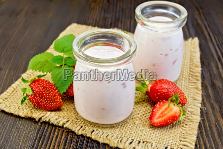 yogurt with strawberries in jars on