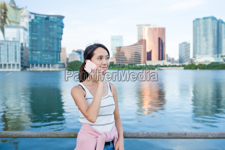 woman chat on cellphone in macao
