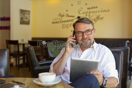 portrait of smiling businessman with digital