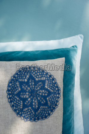 cushion with applicated crochet tablecloth