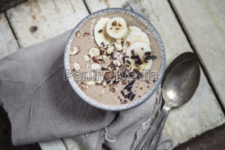 smoothie bowl with bananas roasted hazelnuts