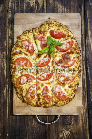homemade pizza with cauliflower and tomatoes