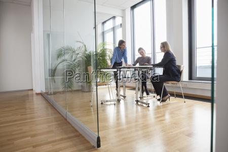 three businesswomen having a meeting