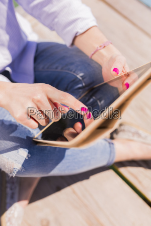 young woman using digital tablet close