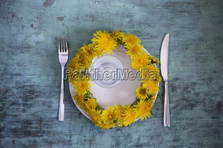 wreath of dandelions on plate