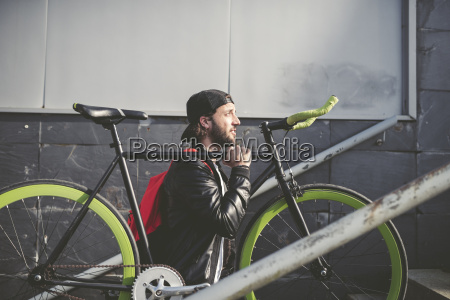 young man carrying fixie bike