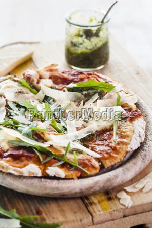 homemade glutenfree pizza with mozzarella rocket