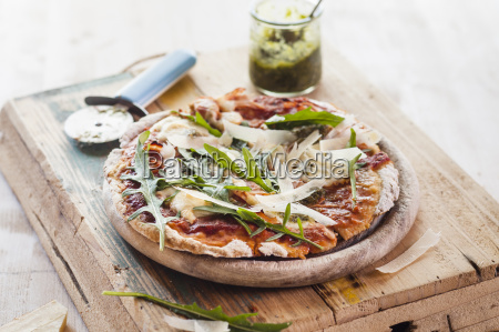 homemade glutenfree pizza with mozzarella rocket