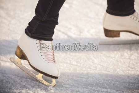 close up of woman ice skating