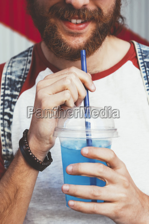 young man with soft drink close