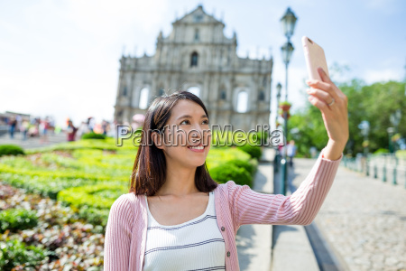 young woman taking mobile phone in