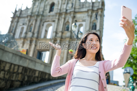 young woman taking selfie by smart