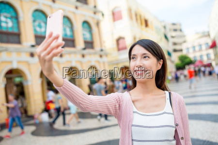 woman taking selfie in senado square