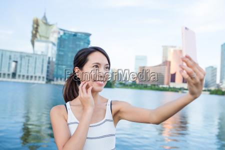 woman taking cellphone in macau