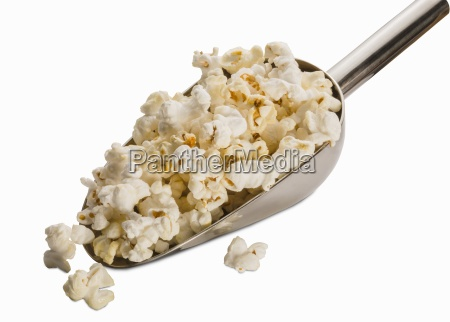 a scoop of popcorn on a
