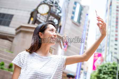 woman taking phone by cellphone in