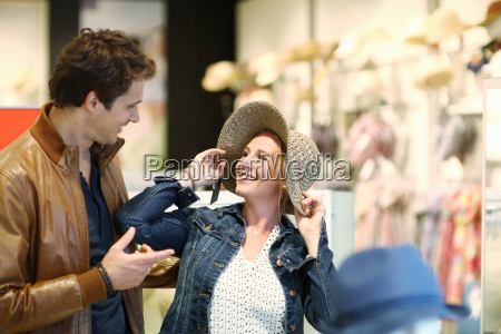 mid adult couple trying on hat