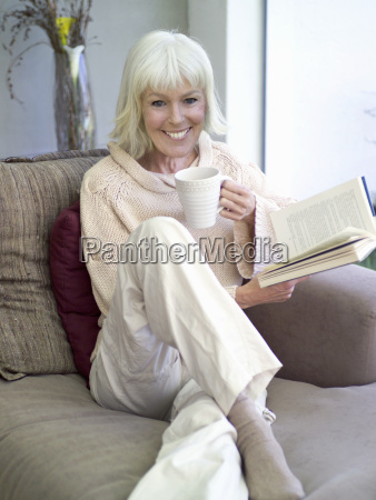 middle aged woman on sofa with