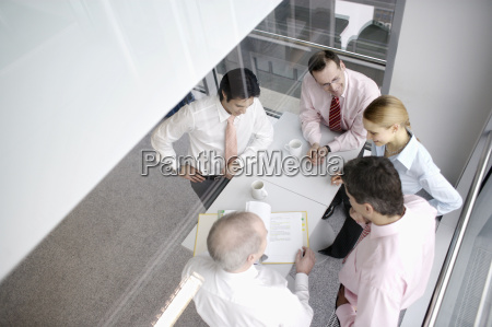 businesspeople discussing paperwork