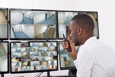 male operator talking on walkie talkie