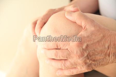 closeup of senior man with soreness