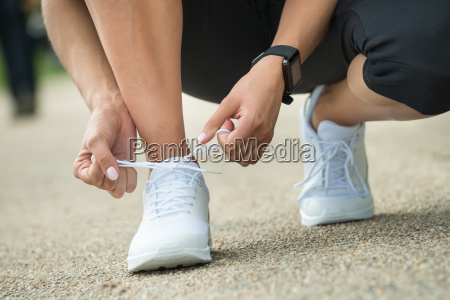 athlete tying shoelaces