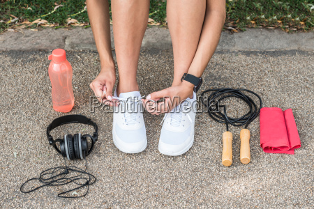 female athlete tying shoelaces