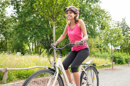 young woman enjoying ride on bicycle