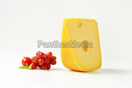 swiss cheese with red grapes