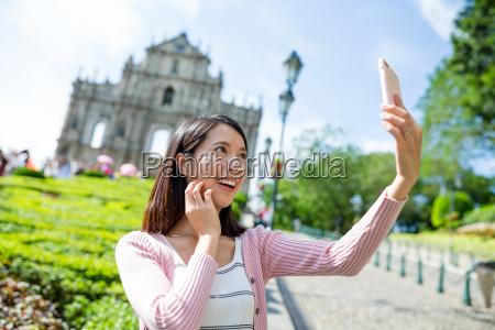 woman taking selfie image in macau