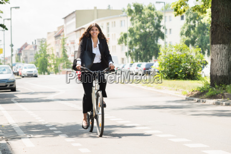 businesswoman riding bicycle