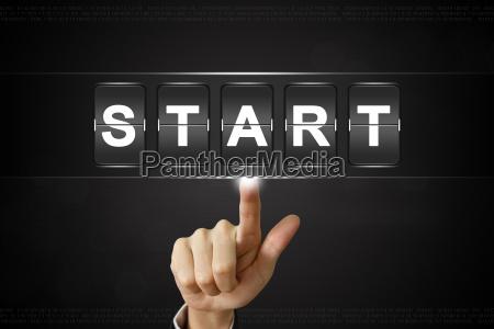business hand clicking start on flipboard