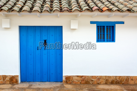colonial building and blue door