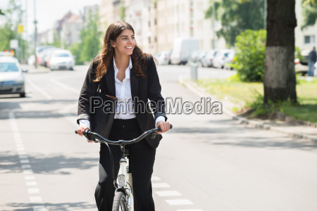 businesswoman commuting on bicycle