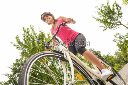 happy female cyclist riding bicycle