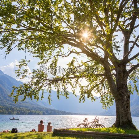 couple enjoying beautiful nature around lake