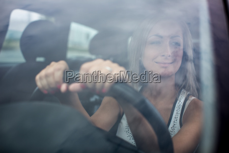 woman driving a car female