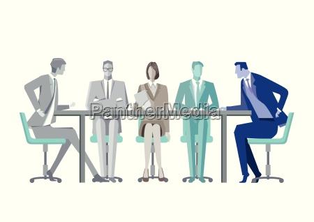 gruppe geschaeftsleute um einen konferenztisch