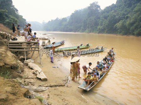 longboat crowded with children leaving for