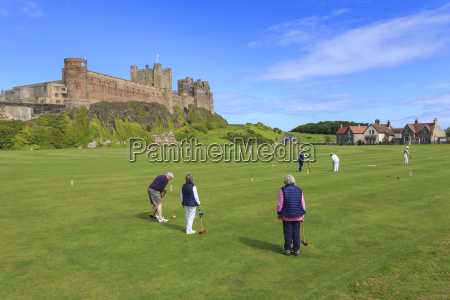 playing croquet beneath bamburgh castle on