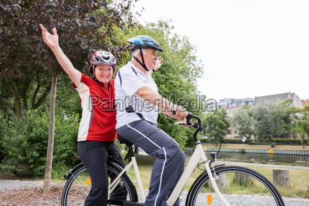 couple enjoying ride on bicycle